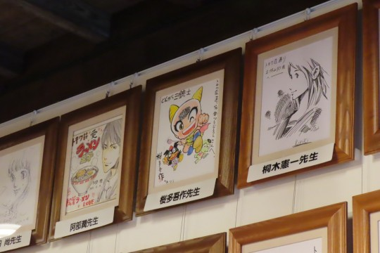 "On the wall of ""Tokiwa-so-dori Rest House"", gorgeous signature colored papers of manga artists line up"